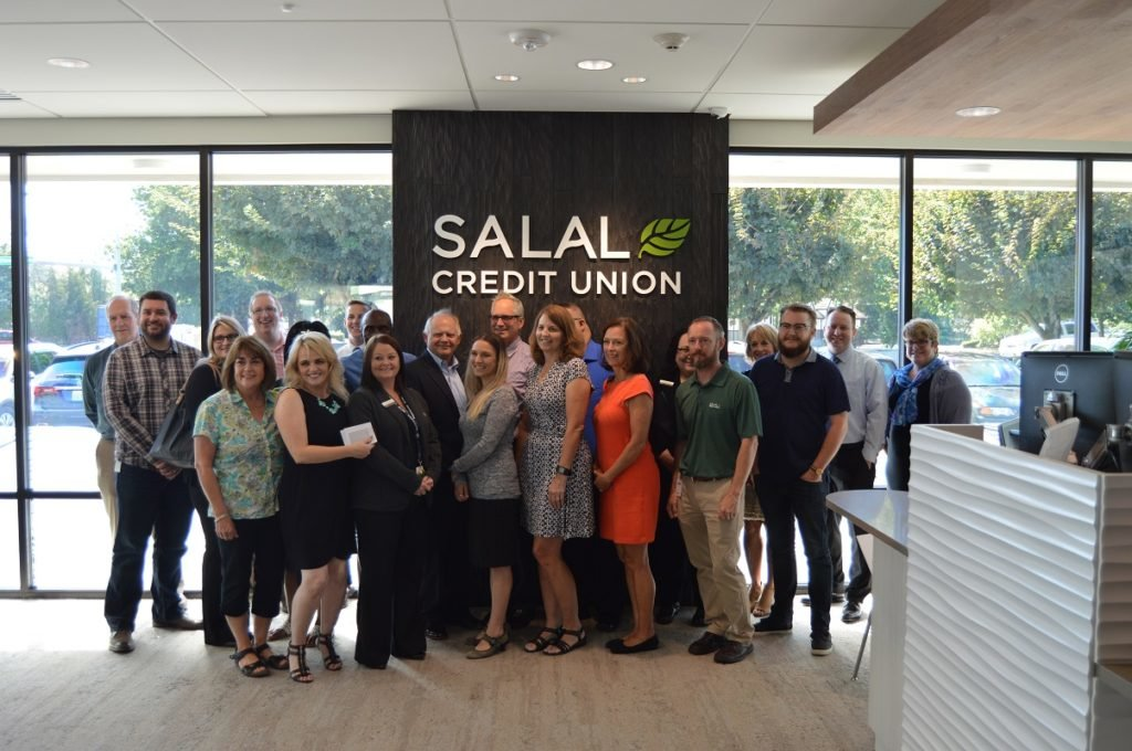 Staff celebrates the Salal Credit Union Tukwila branch grand reopening